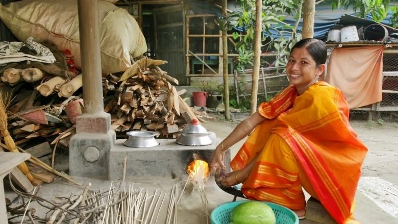 "Ms. Nasrin Akter, from Satkhira in Bangladesh says, ""My cooking time has also reduced because of the improved cookstoves. I am able to spend time with my children before they leave for school."""