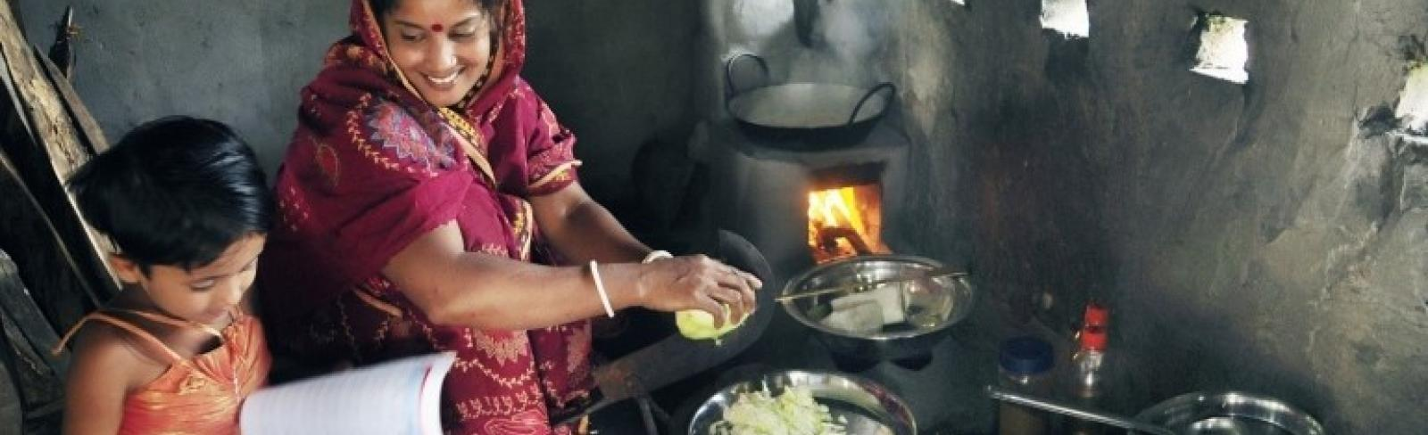 """Improved Cook Stoves are improving health and quality of life especially for women and children by drastically reducing air pollution and costs. """"My firewood usage has gone down so much. I used to buy firewood once in every two months, now I buy fuelwood once every five months. This has helped us save money."""" -Ms. Shefali Ghosh from Savar Village on the outskirts of Dhaka"""