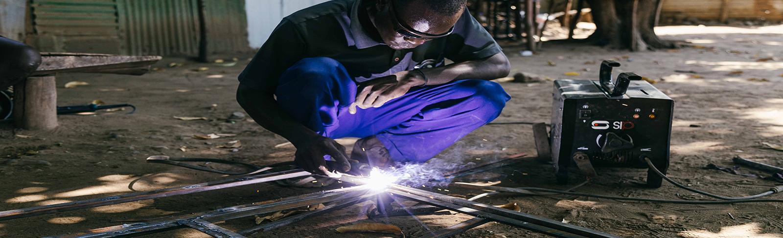 Kenya, welder.