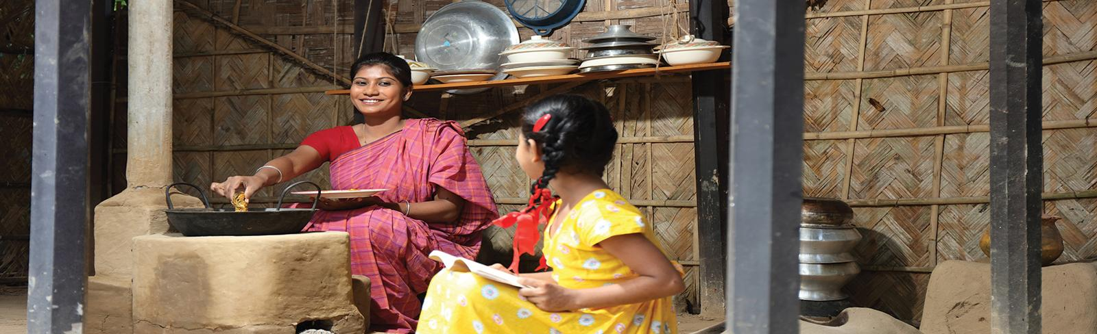 woman and child cooking at home