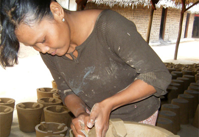 Bangladeshi woman making clay stoves
